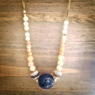 Spanjer necklace of lapis with Tibetan agate, moonstone, and brass. (Photo courtesy Caroylyn Janus)