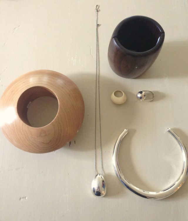 Wooden cuffs and silver pieces by Sophie Buhai.